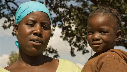 Zimbabwean Woman With A Child