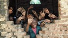 Children waving at their teacher in Africa